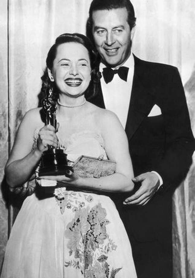 "1947: Olivia de Havilland receives her Best Actress Oscar from actor Ray Milland (1907 - 1986) for her performance in ""To Each his Own,"" directed by Mitchell Leisen. Photo: Getty Images"