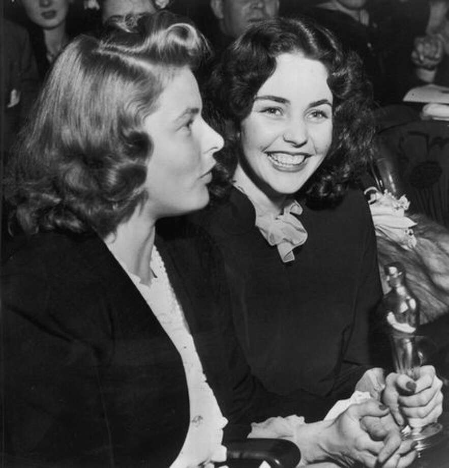 "1944: Actress Jennifer Jones (right) with the Best Actress Oscar she won for her performance in ""Song of Bernadette."" She is with film star Ingrid Bergman. Photo: Getty Images"