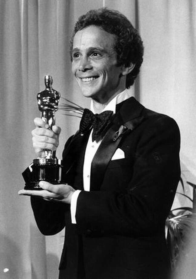 "1973: Actor/dancer Joel Grey with the Oscar he won for Best Supporting Actor for his role in ""Cabaret."" Photo: Getty Images"
