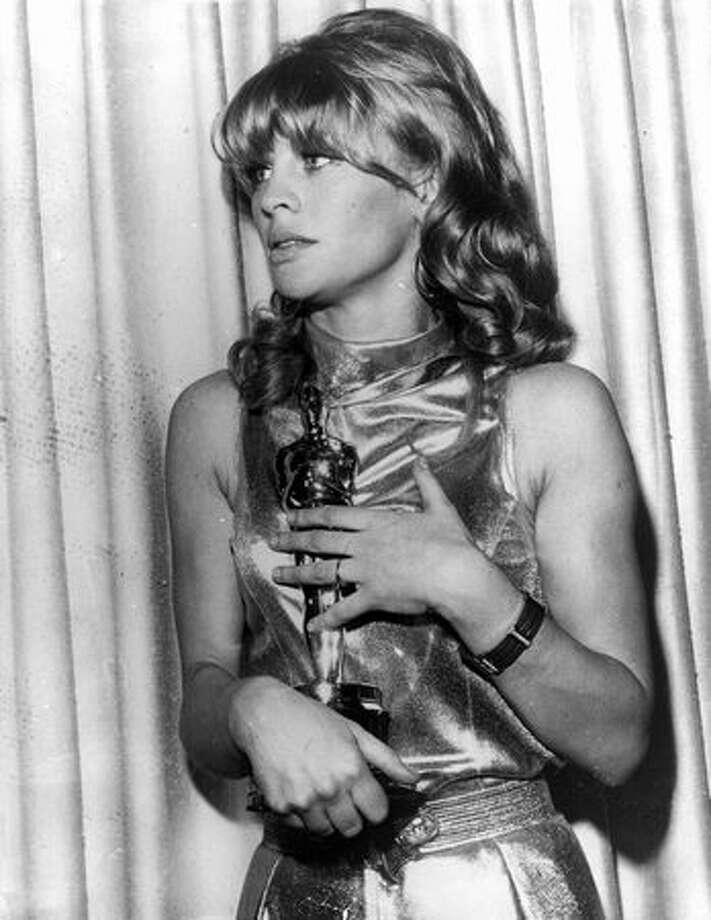 "1966: British actress Julie Christie holds the Best Actress Academy Award she won for her role in the film ""Darling"" at the awards reception at the Civic Auditorium at Santa Monica, Calif. Photo: Getty Images"