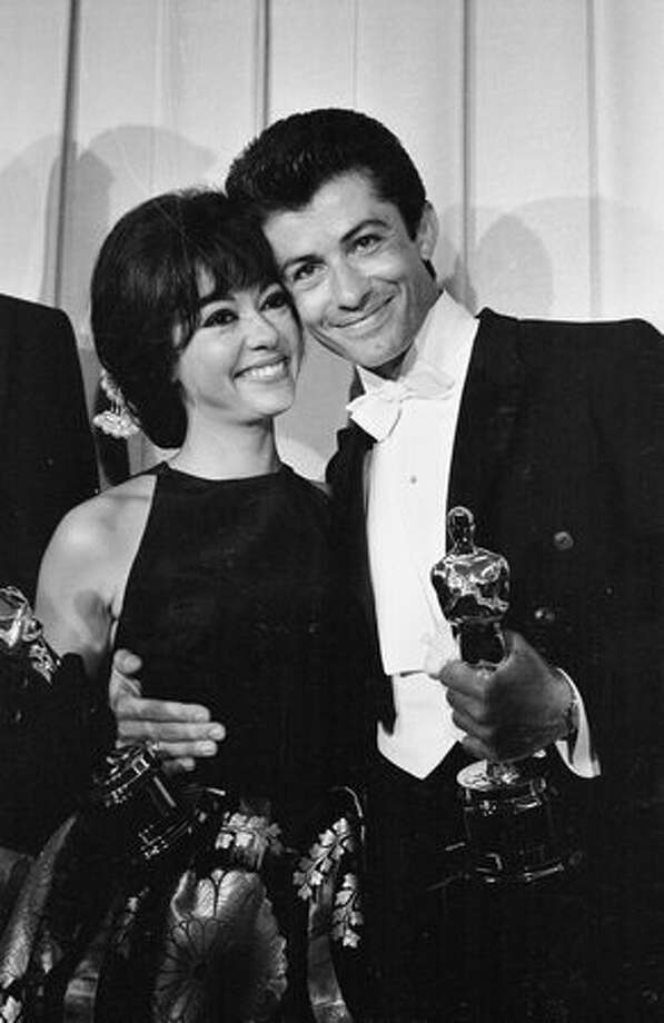 "1962: Actress/singer Rita Moreno and actor George Chakiris holding their Oscars at the award ceremony in Hollywood. The pair won Oscars for supporting roles in ""West Side Story,"" that year's Best Picture. Photo: Getty Images"