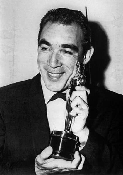 1957: Actor Anthony Quinn (1915 - 2001) showing his Oscar for best actor in a supporting role in