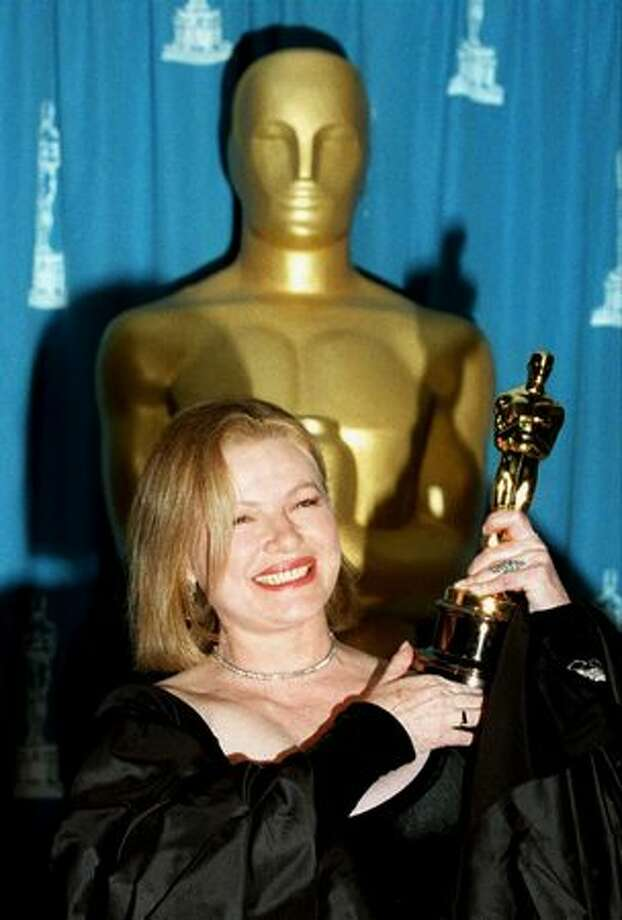 "1995: Actress Dianne Wiest smiles as she holds the Oscar she won during the 67th annual Academy Awards in Los Angeles. Weist won the Best Supporting Actress Oscar for her role in ""Bullets Over Broadway."" Photo: Getty Images"