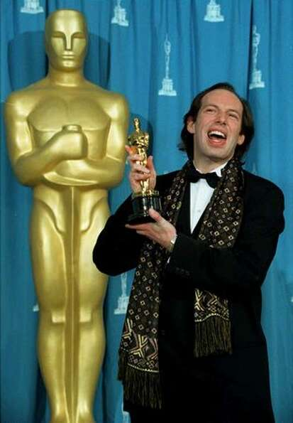 1995: Composer Hans Zimmer holds the Oscar he won for best original score for the animated film