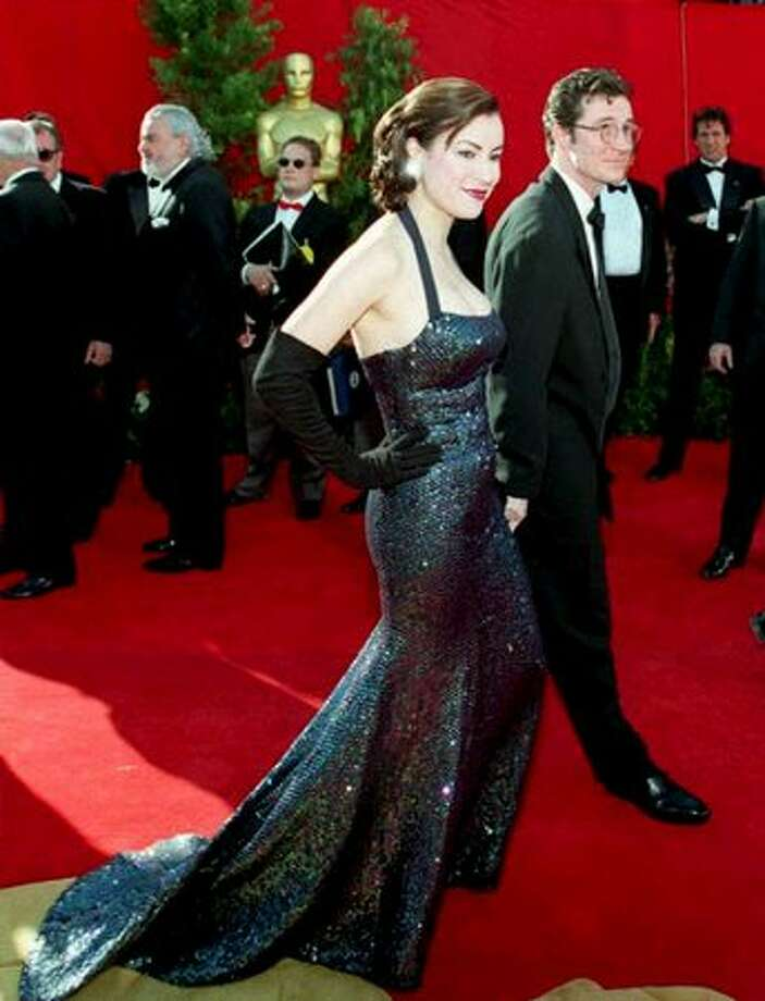"""1995: Actress Jennifer Tilly, nominated in the best supporting actress category for her role in Woody Allen's """"Bullets Over Broadway,"""" arrives for the 67th annual Academy Awards in Los Angeles. Photo: Getty Images"""