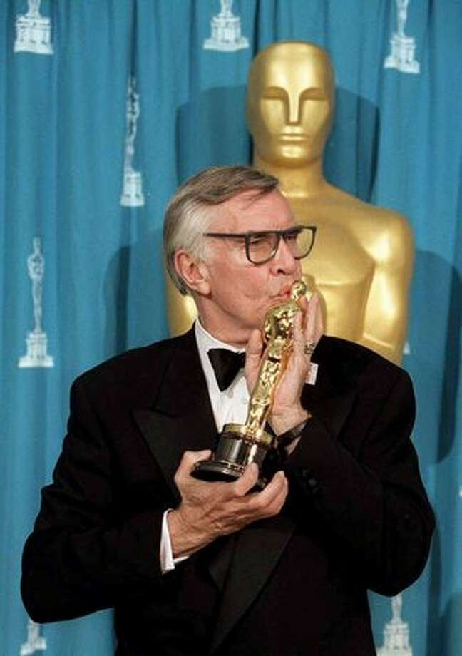 "1995: Veteran actor Martin Landau kisses his Oscar at the 67th annual Academy Awards in Los Angeles. Landau won the Oscar for his supporting role as the actor Bela Lugosi in the film ""Ed Wood."" Photo: Getty Images"