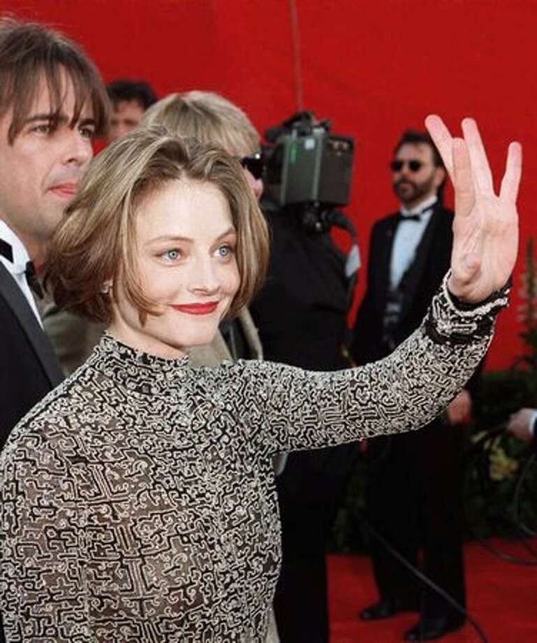 "1995: Actress Jodie Foster waves to fans as she arrives at the 67th Academy Awards ceremony in Los Angeles. Her nomination for best actress for her role in the film ""Nell"" was her fourth Oscar nomination. Photo: Getty Images"