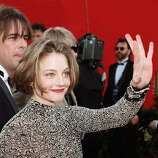 "1995: Actress Jodie Foster waves to fans as she arrives at the 67th Academy Awards ceremony in Los Angeles. Her nomination for best actress for her role in the film ""Nell"" was her fourth Oscar nomination."