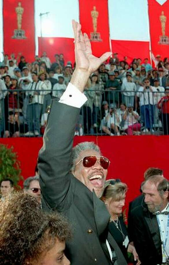 "1995: Actor Morgan Freeman waves to the crowd as he arrives at the Shrine Auditorium for the 67th annual Academy Awards ceremonies in Los Angeles. Freeman was nominated for his role as ""Red Redding,"" the prison fixer in ""The Shawshank Redemption."" Photo: Getty Images"