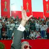 "1995: Actor Morgan Freeman waves to the crowd as he arrives at the Shrine Auditorium for the 67th annual Academy Awards ceremonies in Los Angeles. Freeman was nominated for his role as ""Red Redding,"" the prison fixer in ""The Shawshank Redemption."""