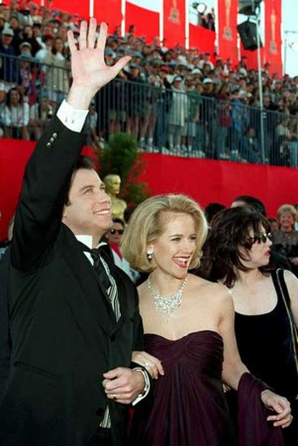 "1995: Oscar nominee for best actor, John Travolta, arrives with his wife, actress Kelly Preston at the 67th Academy Awards in Los Angeles. Travolta was nominated for his role as Vincent Vega in Quentin Tarantino's hit film ""Pulp Fiction."" Photo: Getty Images"