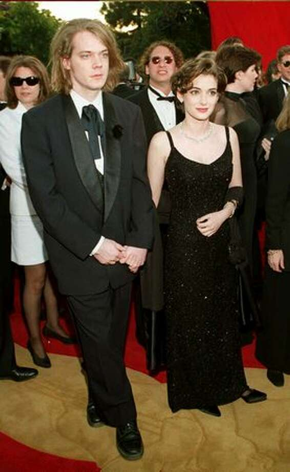 "1995: Actress Winona Ryder arrives for the 67th annual Academy Awards with her boyfriend David Pirner in Los Angeles. Ryder received a nomination for best actress for her role in ""Little Women."" Photo: Getty Images"