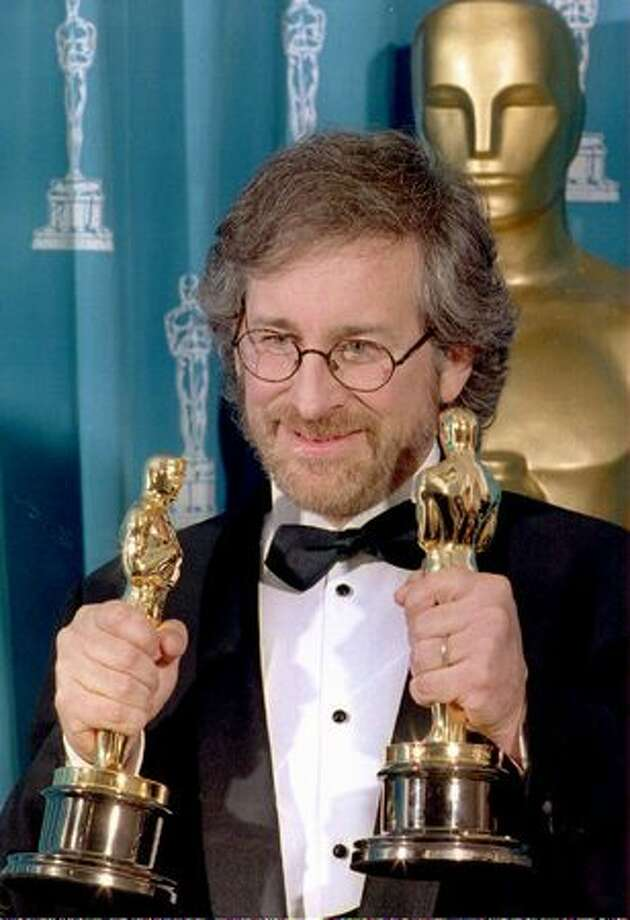 "1994: Director Steven Spielberg poses with his two Oscars in Los Angeles during the 66th annual Academy Awards ceremony after winning the awards for best director and best picture for his movie ""Schindler's List."" Spielberg had been nominated for best director three times in the past but had never won an Oscar. Photo: Getty Images"