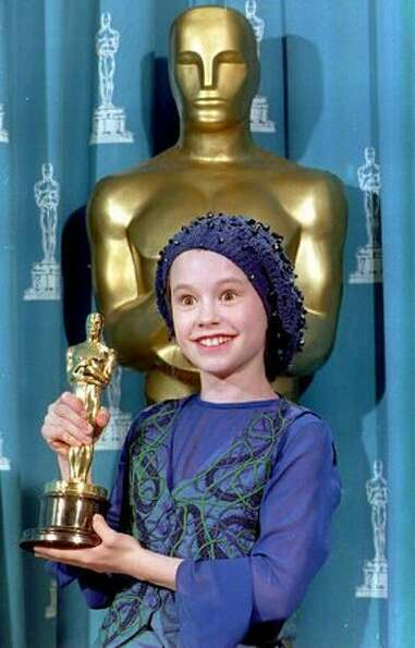 1993: Actress Anna Paquin of New Zealand poses with the Oscar she received for best supporting actre