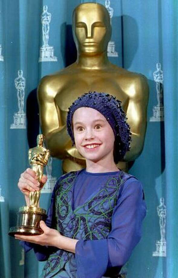 "1993: Actress Anna Paquin of New Zealand poses with the Oscar she received for best supporting actress during the 66th annual Academy Awards in Los Angeles. Paquin, 11, won for her performance in the movie ""The Piano."" Photo: Getty Images"