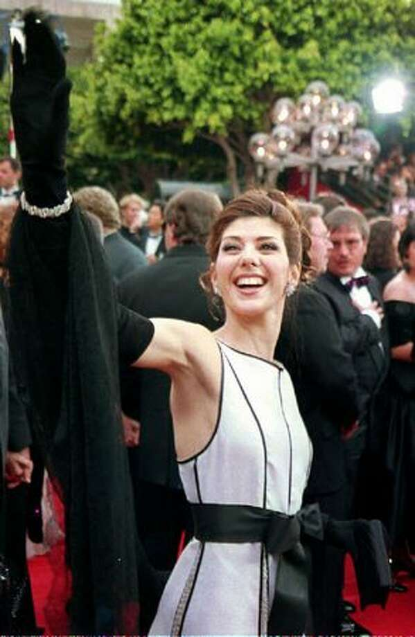 "1993: Actress Marisa Tomei waves as she arrives at the 65th Annual Academy Awards. Tomei won Best Supporting Actress for her role in the film ""My Cousin Vinny."" Photo: Getty Images"