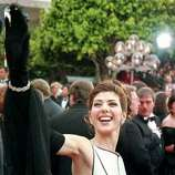 "1993: Actress Marisa Tomei waves as she arrives at the 65th Annual Academy Awards. Tomei won Best Supporting Actress for her role in the film ""My Cousin Vinny."""
