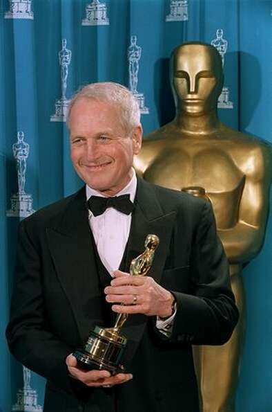 1994: Paul Newman poses with the Jean Hershholt Humanitarian Award which was presented to him during