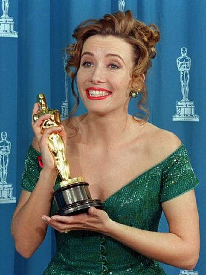 "1993: Actress Emma Thompson reacts as she poses with her Oscar at the 65th annual Academy Awards after winning the Best Actress category for her role in ""Howards End."" Photo: Getty Images"
