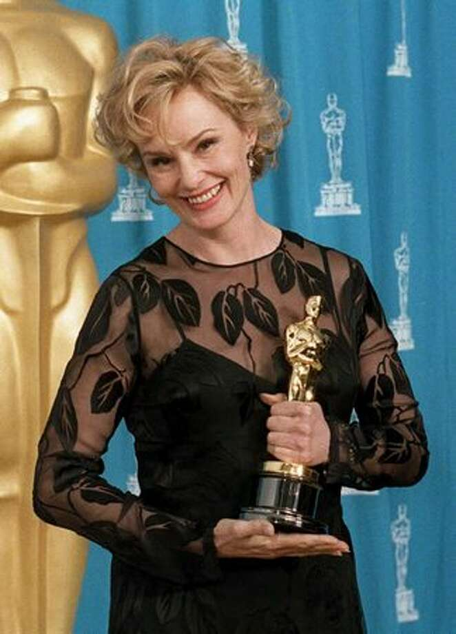 "1995: Actress Jessica Lange holds the Oscar she won for her role as Carly Marshall in the film ""Blue Sky"" at the Academy Awards in Los Angeles. Lange starred with previous Oscar recipient Tommy Lee Jones in the film. Photo: Getty Images"