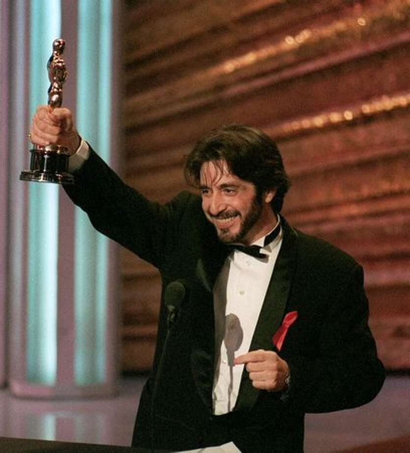 "1993: Actor Al Pacino holds up his Oscar during the 65th annual Academy Awards ceremony after being presented the Best Actor award for his performance in Martin Brest's ""Scent of a Woman."" Photo: Getty Images"