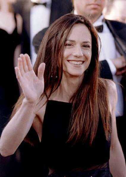 1994: Actress Holly Hunter waves to fans as she arrives at the Dorothy Chandler Pavilion in Los Ange