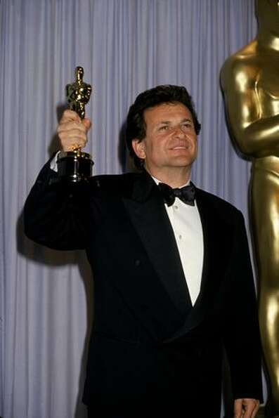 1991: Actor Joe Pesci smiles as he holds up his Oscar for Best Supporting Actor for his role in