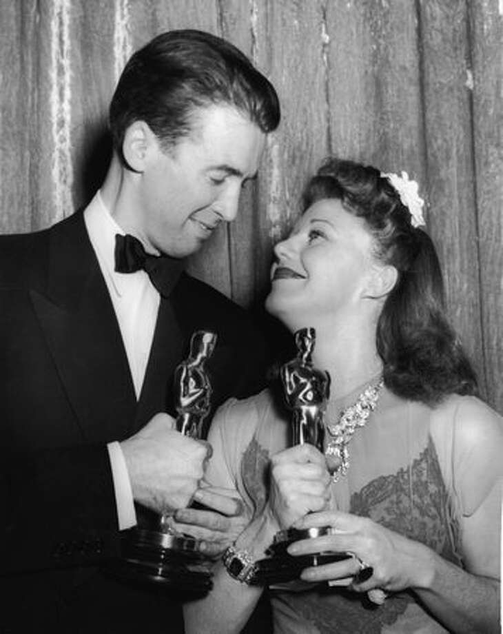 "1941: Actors James Stewart (1908 - 1997) and Ginger Rogers (1911 - 1995) at the Academy Awards banquet, Los Angeles. Stewart won Best Actor in a Leading Role for his performance in ""The Philadelphia Story"" while Rogers won Best Actress in a Leading Role for her performance in ""Kitty Foyle: The Natural History of a Woman."" Photo: Getty Images"