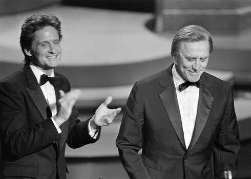 1985: Actor Michael Douglas applauds his father, actor Kirk Douglas, during the 57th annual Academy Awards in Hollywood. Photo: Getty Images