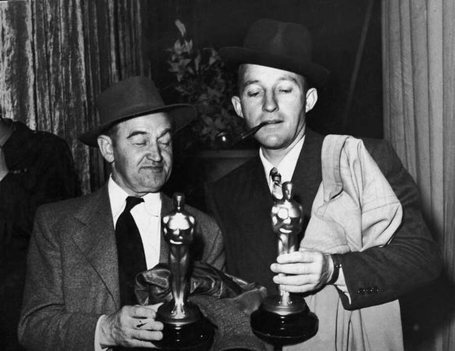 "1945: Actor Barry Fitzgerald (1888 - 1966) (left) holds his Oscar for Best Supporting Actor while actor Bing Crosby (1904 - 1977) holds his Oscar for Best Actor, both for their roles in ""Going My Way,"" in Los Angeles. Photo: Getty Images"