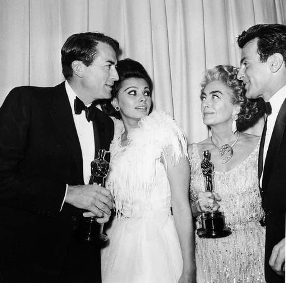"1963: From left, actors Gregory Peck (1916 - 2003), Sophia Loren, Joan Crawford (1904 - 1977) and Fernando Lamas (1915 - 1982) stand backstage at the Santa Monica Civic Auditorium. Peck won Best Actor for director Robert Mulligan's film ""To Kill a Mockingbird."" Crawford accepted the Best Actress award for Anne Bancroft for director Arthur Penn's film ""The Miracle Worker."" Photo: Getty Images"
