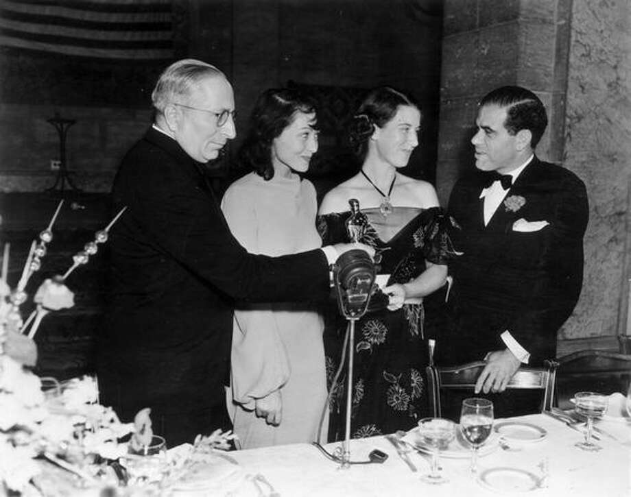 "1938: Luise Rainer (second right) wins the Best Actreess Oscar for the second straight year for ""The Good Earth,"" here with (from left) studio boss Louis Mayer, Louise Tracy, wife of Spencer Tracy, and director Frank Capra at the Biltmore Hotel in Los Angeles. Photo: Getty Images"