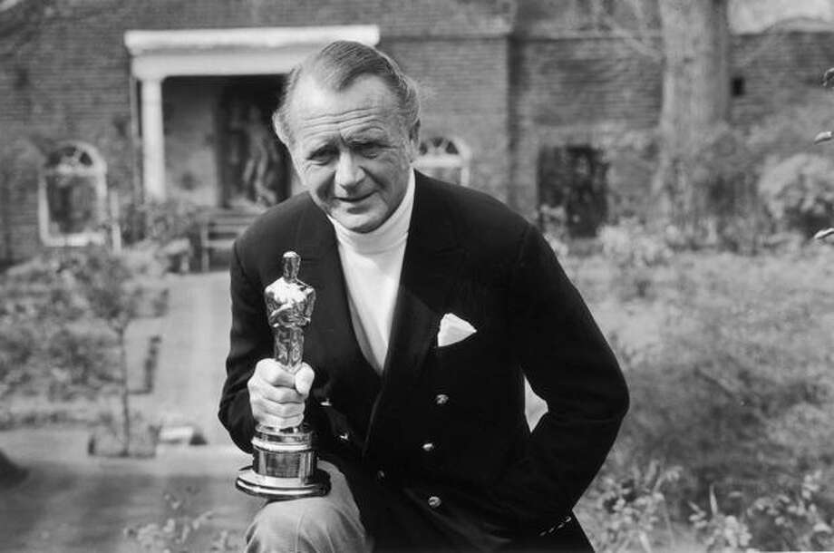 "1971: English actor John Mills holding the Best Supporting Actor Oscar which he won for his role in the David Lean film ""Ryan's Daughter."" Photo: Getty Images"