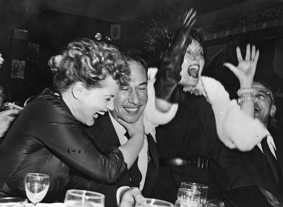 "1951: Actor Jose Ferrer (1912 - 1992) hears the news that he has won a Best Actor Academy Award for his performance in ""Cyrano de Bergerac"" while at a cafe in New York. Sharing his euphoria are actresses Judy Holliday (1922 - 1965) and Gloria Swanson (1897 - 1983), right. Photo: Getty Images"