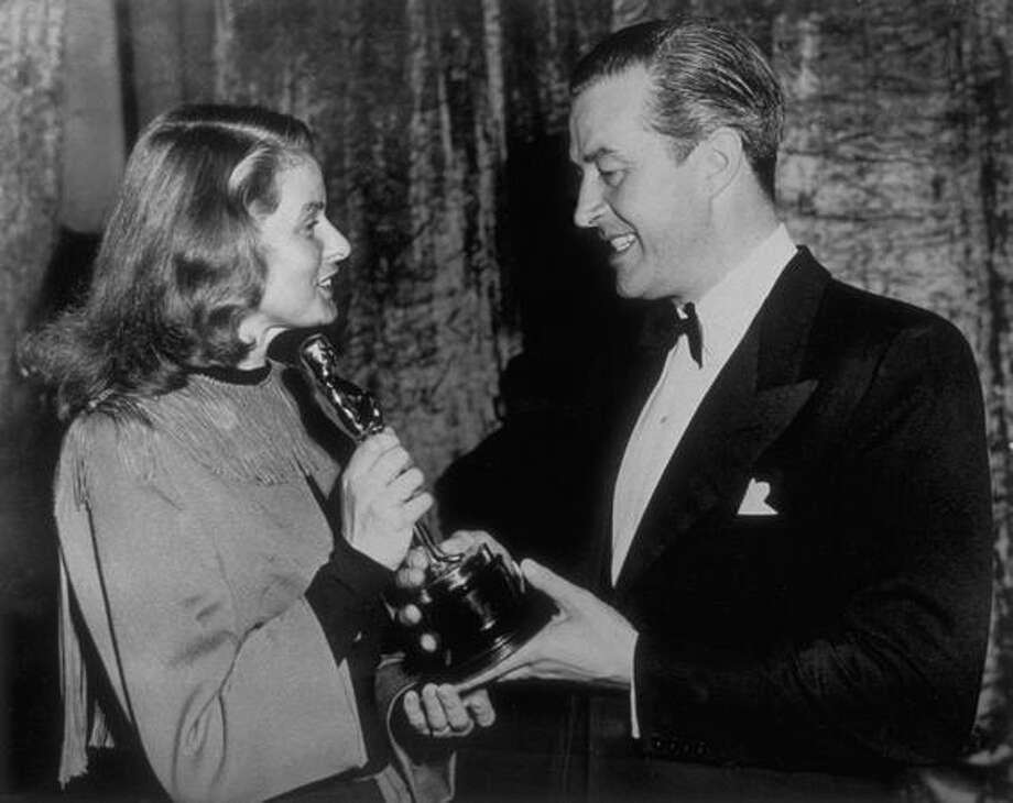 "1946: Ingrid Bergman (1915 - 1982) presenting Ray Milland (1907 - 1986) with the Oscar for best actor (in ""The Lost Weekend"") at the Academy Awards ceremony in Hollywood. Photo: Getty Images"