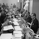 1962: Journalists typing up their reports in the press room at the Oscars award ceremony in Hollywood.