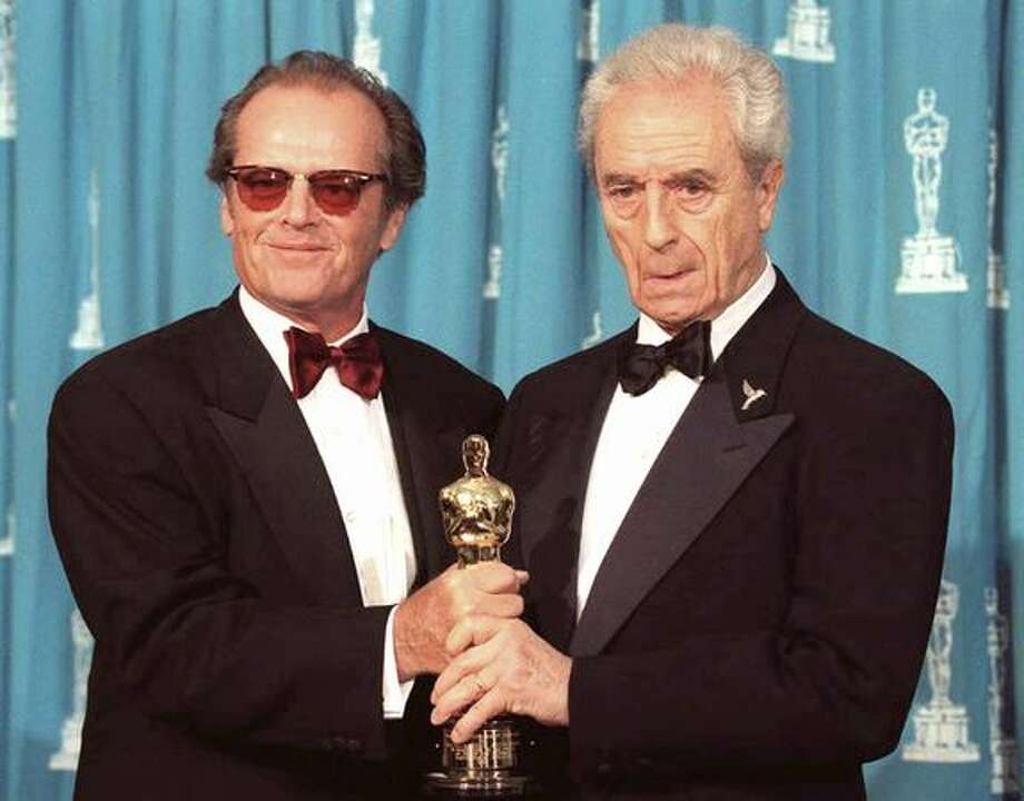 1995: Actor Jack Nicholson (left) poses with Italian film director Michelangelo Antonioni at the 67th annual Academy Awards in Los Angeles. Antonioni received an honorary Oscar from Nicholson for his lifetime career in film. Photo: Getty Images