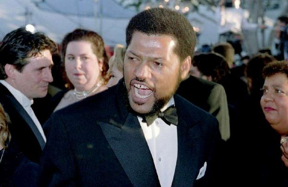 "1994: Actor Laurence Fishburne talks to reporters as he arrives at the Dorothy Chandler Pavilion in Los Angeles for the 66th annual Academy Awards. Fishburne was nominated for best actor for his role in ""What's Love Got To Do With It."" Photo: Getty Images"