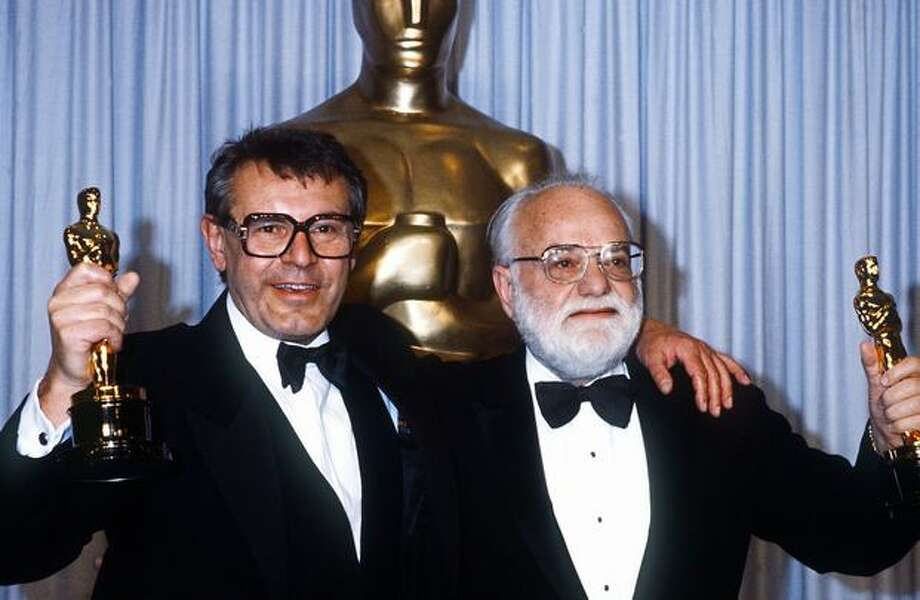 "1985: Milos Forman (left) and Saul Zaentz, director and producer of ""Amadeus,"" a movie based on the life of Wolfgang Amadeus Mozart, hold their Oscars. ""Amadeus"" won a remarkable 11 Oscars, including Best Picture and Best Director. Photo: Getty Images"