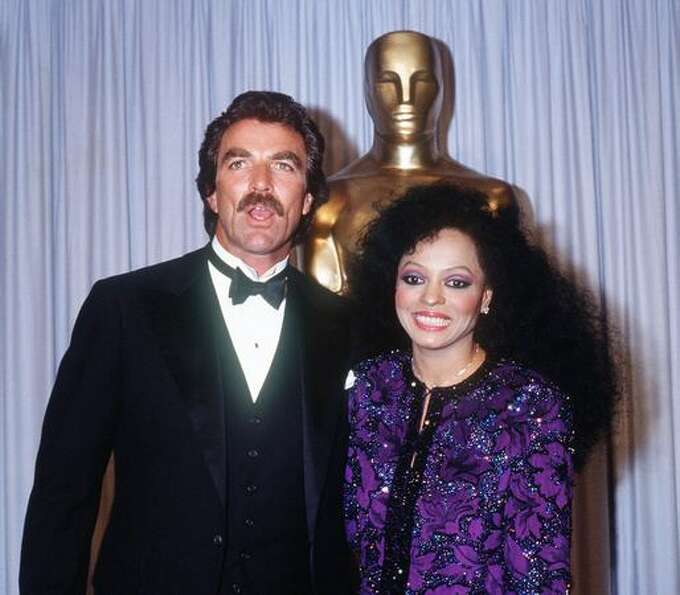 1985: Actor Tom Selleck and actress and pop diva Diana Ross smile during the 57th annual Academy Awa