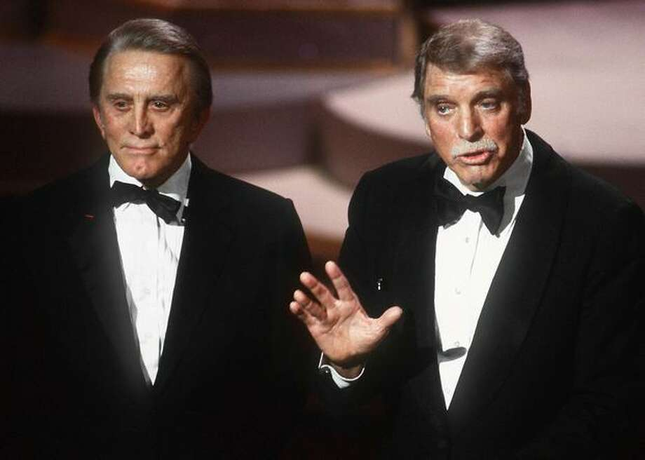1985: Veteran actors Kirk Douglas (left) and Burt Lancaster address the guests in Hollywood at the 57th annual Academy Awards. Photo: Getty Images