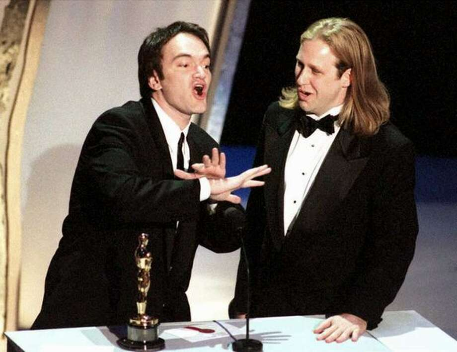 "1995: Co-writers Quentin Tarantino (left) and Roger Avary accept the Oscar for best original screenplay for the film ""Pulp Fiction."" Tarantino also directed the film. Photo: Getty Images"