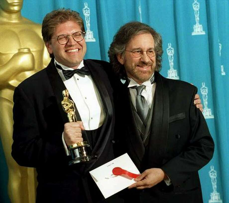 "1995: Director Robert Zemeckis (left) holds the Oscar he won as Best Director for the film ""Forrest Gump"" as he poses with Steven Spielberg, who presented the award. ""Forrest Gump"" won six Oscars, including best picture, best actor, and best director. Photo: Getty Images"
