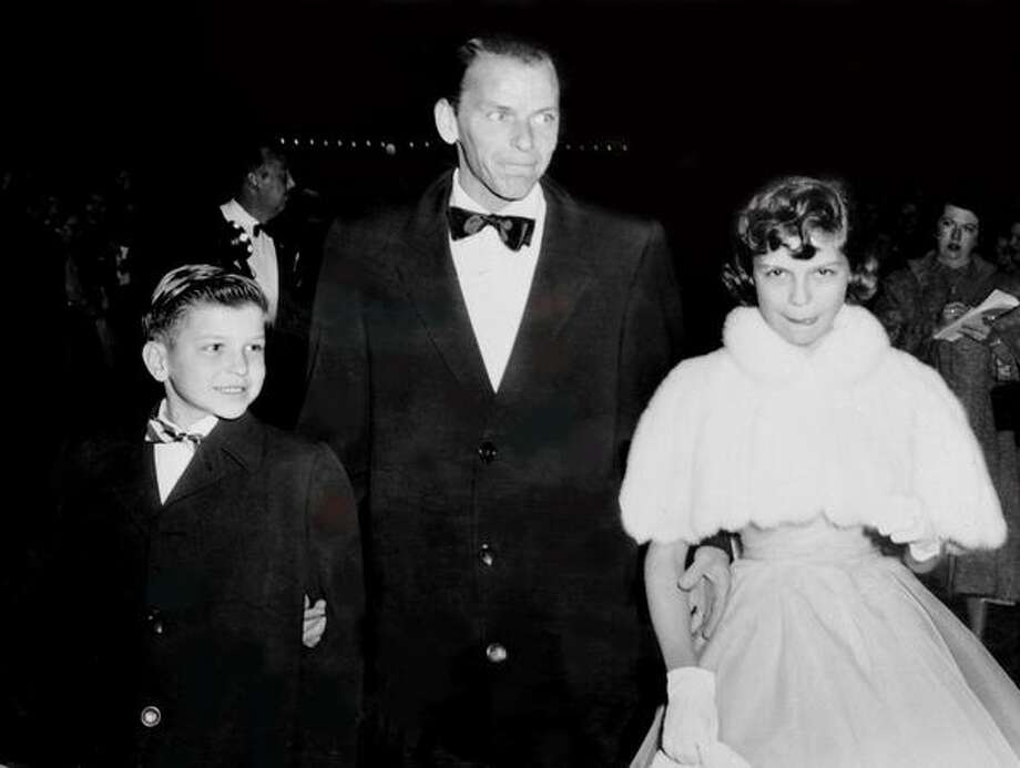 "1954: Legendary singer Frank Sinatra arrives with his son Frank Jr. and daughter Nancy at the RKO-Pantages Theater for the Academy Awards. Sinatra received an Oscar as the Best Supporting Actor for his role in ""From Here to Eternity."" Photo: Getty Images"