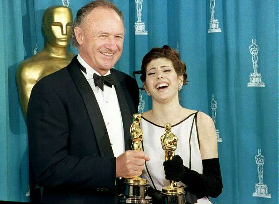 "1993: Actor Gene Hackman and actress Marisa Tomei pose with their Oscars shortly after being respectively awarded best supporting actor and best supporting actress. Hackman won for his role in ""Unforgiven"" and Tomei for ""My Cousin Vinny."" Photo: Getty Images"