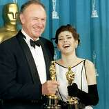 "1993: Actor Gene Hackman and actress Marisa Tomei pose with their Oscars shortly after being respectively awarded best supporting actor and best supporting actress. Hackman won for his role in ""Unforgiven"" and Tomei for ""My Cousin Vinny."""