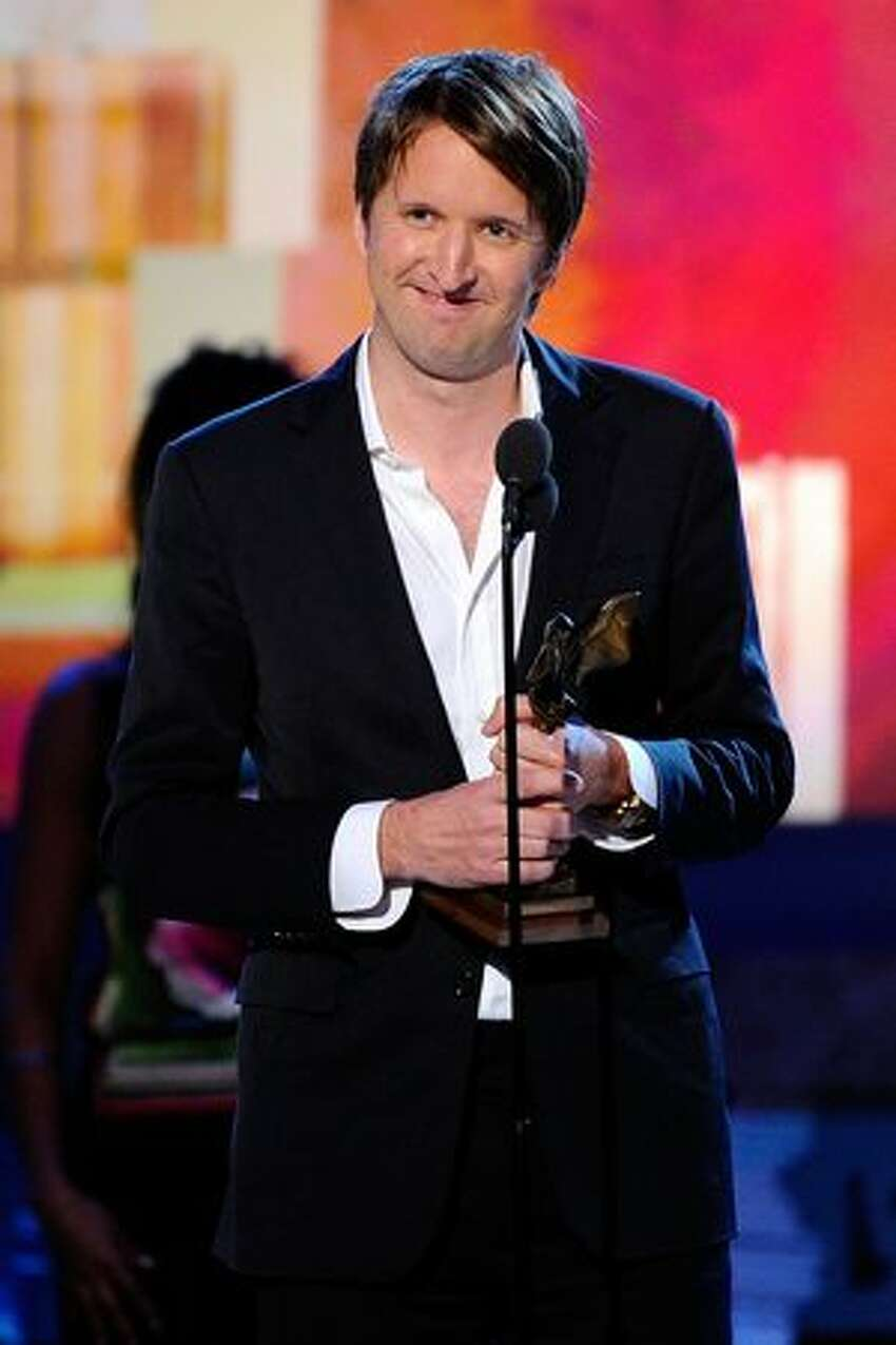 Director Tom Hooper, winner of Best Foreign Film award for 'The King's Speech,' accepts award onstage.