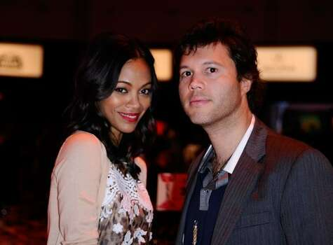 Actress Zoe Saldana (L) and guest in the audience. Photo: Getty Images