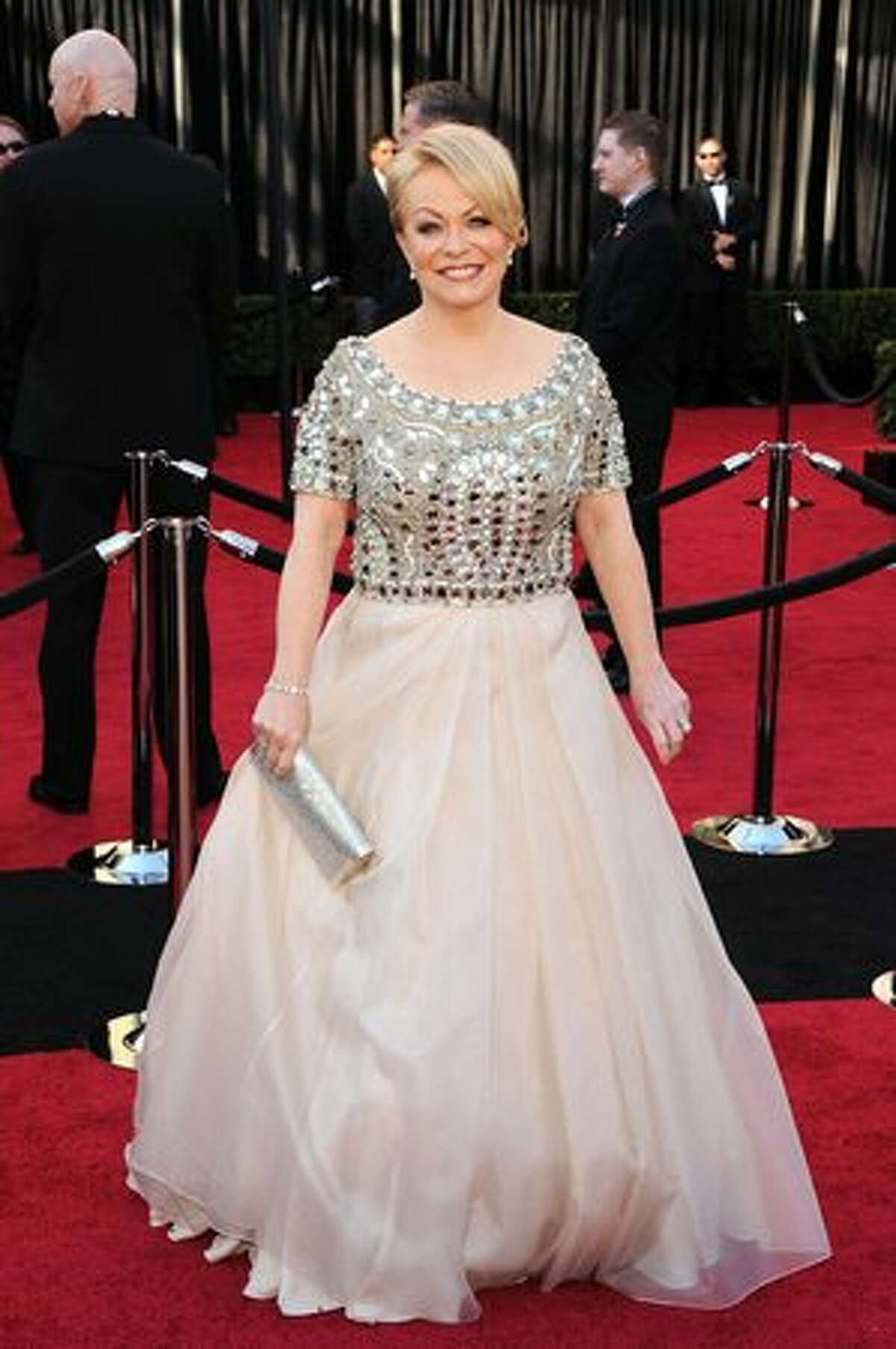 Best Supporting Actress nominee Jacki Weaver, as we pointed out at the Golden Globes, has a challenge trying to dress for these events due to her build. This is a big improvement over what she wore then, but it's still ugly. Dressing women like this is not impossible, but she needs some different advice.