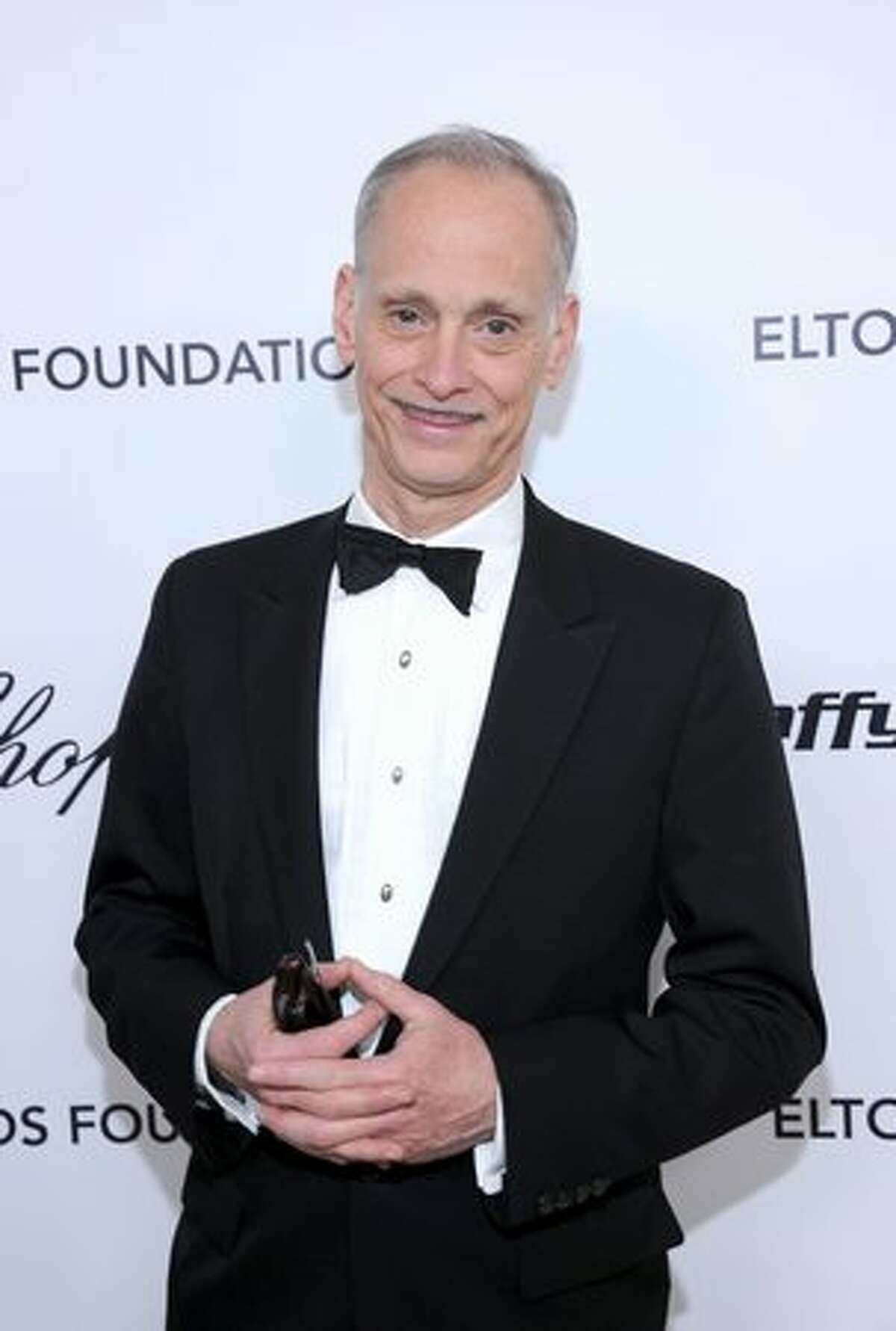 Filmmaker John Waters arrives at the 19th Annual Elton John AIDS Foundation Academy Awards Viewing Party at the Pacific Design Center in West Hollywood, California.